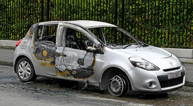 The car set on fire in Beechmount Avenue