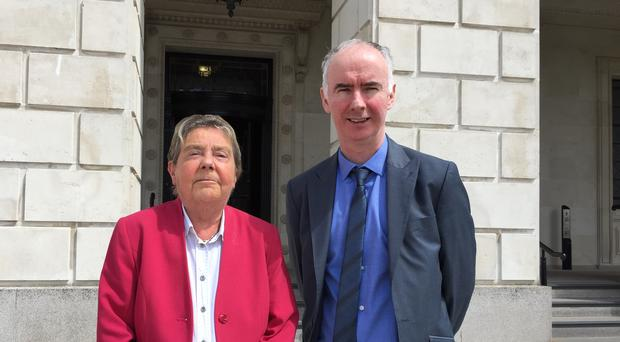Professor Eileen Evason and Advice NI's head of policy Kevin Higgins outside Parliament Buildings, Stormont (PA)