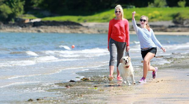 Grainne and daughter Hannah with their dog Sally at Helen's Bay