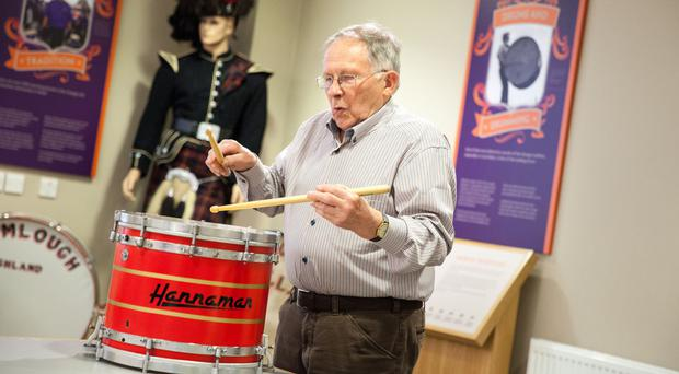 Veteran pipe band drummer Wilby Hanna (Upper Crossgare LOL 1608) playing one of the innovative drums he designed and built back in 1981