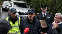 Howard Hughes (centre) and John Owens (left), of the Air Accident Investigation Unit, along with Superintendent Martin Walker (right), speak to the media near the scene in Belan, Moone (Brian Lawless/PA)
