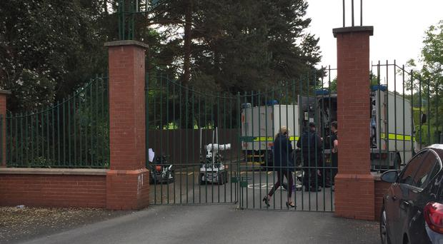 Police and army bomb disposal experts at Shandon Park Golf Club in east Belfast to examine a suspect device under a car in the car park. A special tournament being held at the Shandon Park club was cancelled and at least 70 people evacuated
