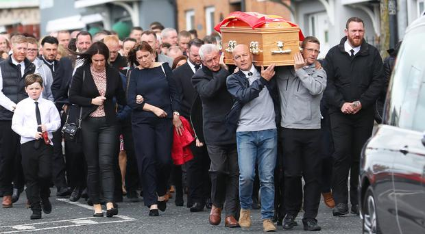 Family and friends carry the coffin of Colin McGarry along the Oldpark Road in north Belfast for his funeral service at Sacred Heart Parish Church