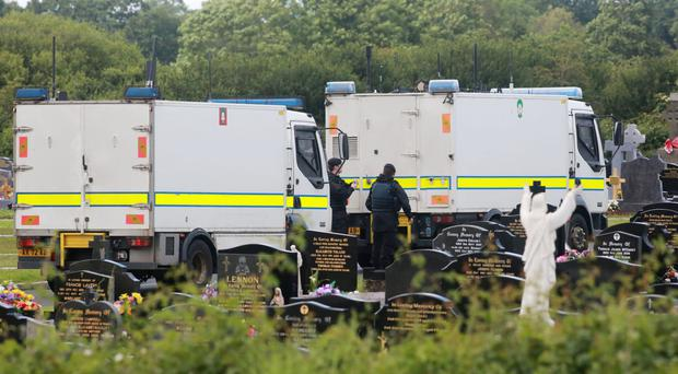 Army Bomb Disposal team are seen in the grounds of St Coleman's Cemetery, Lurgan