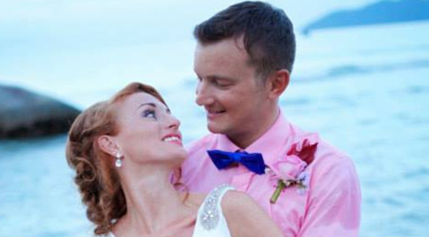 Lisa and Paul Connell at their wedding on a Vietnam beach in 2014