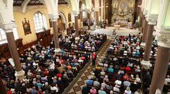 Hundreds of worshippers attend the Novena at Clonard Monastery in west Belfast yesterday