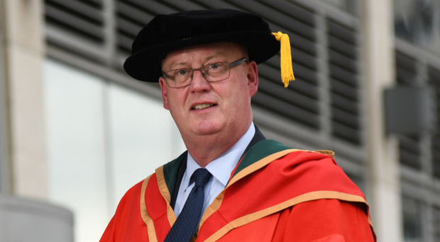 George Hamilton with his honorary award from Ulster University