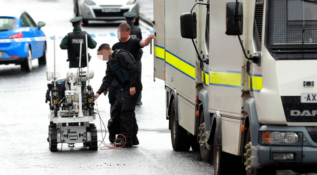 Police and Army bomb experts at the scene in north Belfast