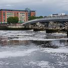 Officials say the frothy substance spotted on the River Lagan will dissipate in the coming days