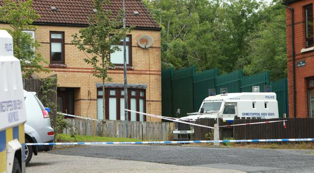 Police at the scene of the tragedy at Woodside Drive in Poleglass yesterday