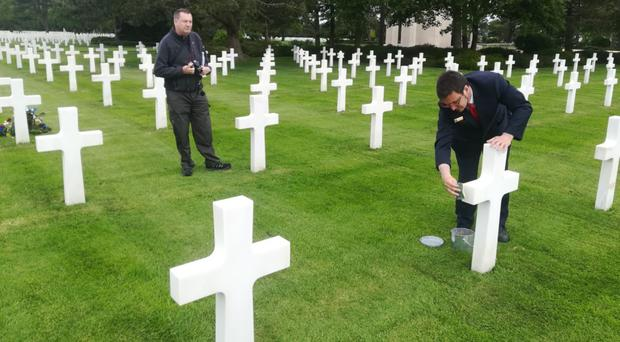 Andy Glenfield visits the grave of US soldier Tony Vickery in Normandy