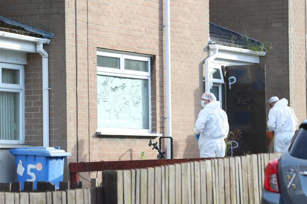 Forensic experts at the house where Paul Smyth was found dead
