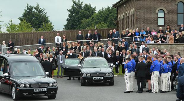Mourners outside Church of the Nazarene in Lurgan for the funeral of 11-year-old Jack Roycroft yesterday