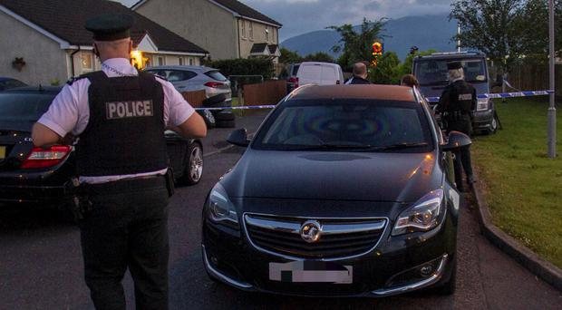 PSNI attend the crime scene at Carn View in Newry