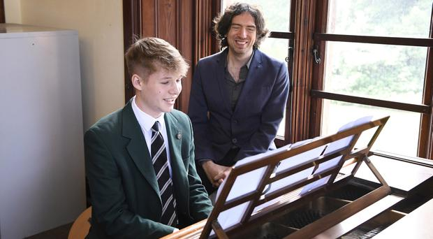 Gary Lightbody sings a duet with pupil George Robinson