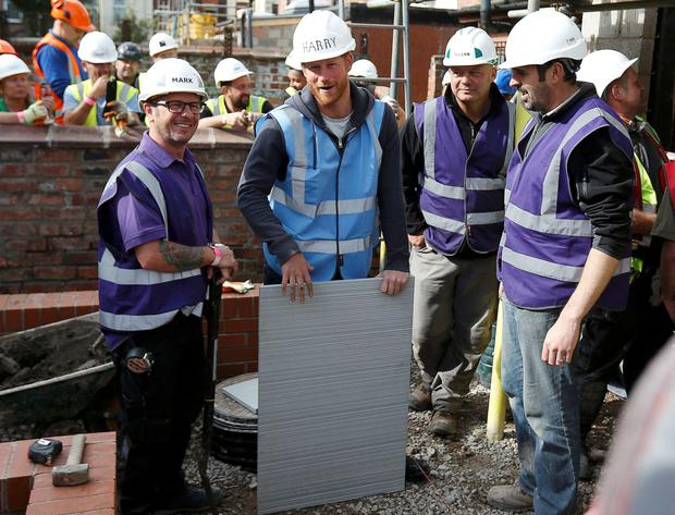 Mark Millar and Prince Harry working on the SOS project for veterans