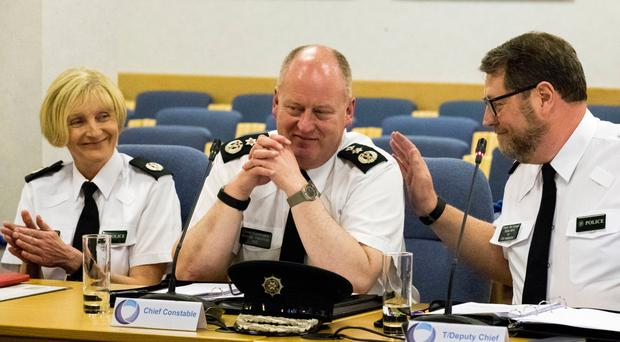 Outgoing PSNI Chief Constable Sir George Hamilton with colleagues Stephen Martin and Barbara Gray at his final meeting of Policing Board