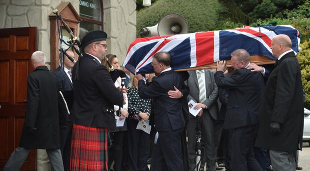 Willie Frazer's coffin is carried into Fivemilehill Pentecostal Church in Bessbrook yesterday