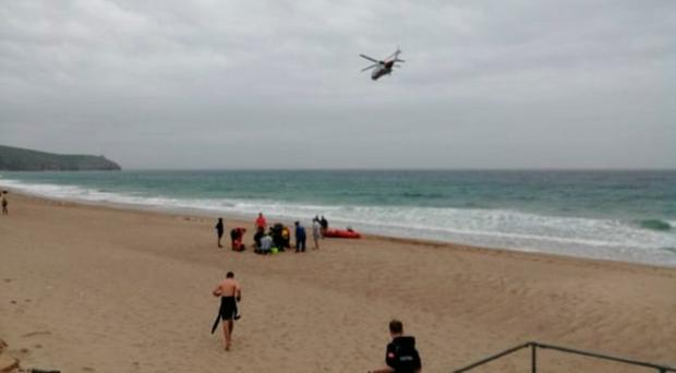 Emergency services at the scene off the Cornwall coast