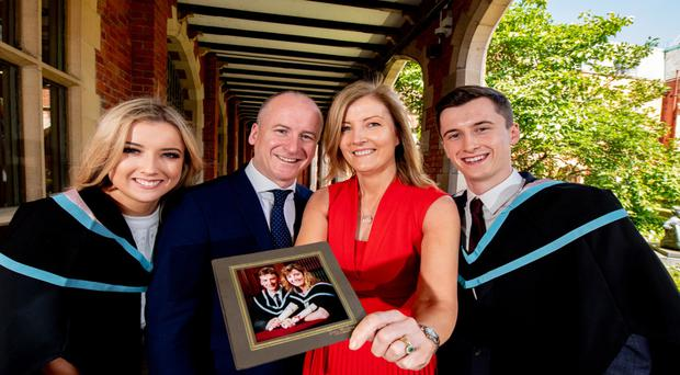 Brother and sister Matthew and Fiona Nethercott with their parents, Siobhan and Andrew, who also graduated from Queen's