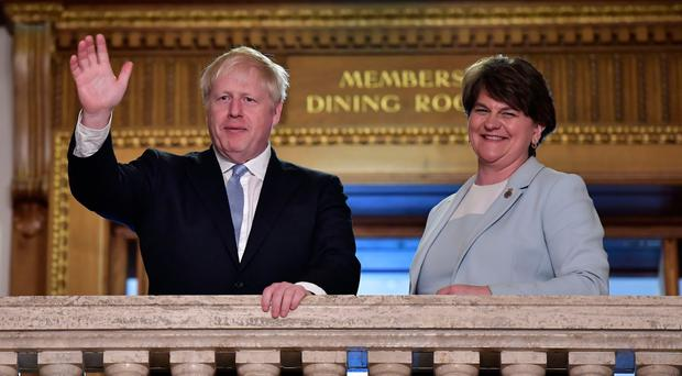 Boris Johnson with DUP leader Arlene Foster at Parliament Buildings, Stormont yesterday