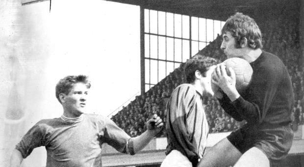 Linfield's Sammy Pavis (left) challenges Terry Nicholson for the ball in 1968