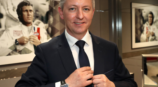 Peter McAlister, Tag Heuer Belfast boutique manager, wearing the Monaco watch
