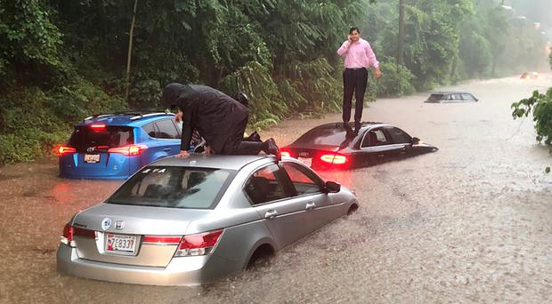 Motorists stranded on Canal Road in Washington DC during a rainstorm yesterday