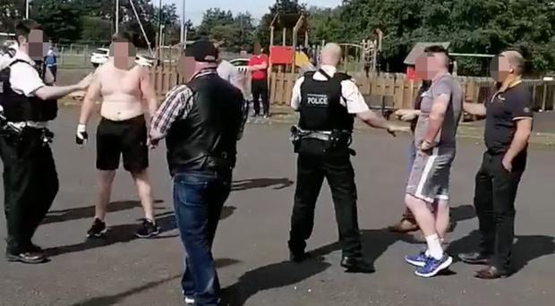 Images from footage of the incident in Coalisland on Sunday show police breaking up the among two Travellers