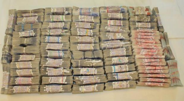 Bundles of cash seized by HMRC (HMRC/PA)