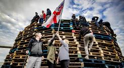 Loyalists make their feelings known at the Avoniel bonfire in east Belfast