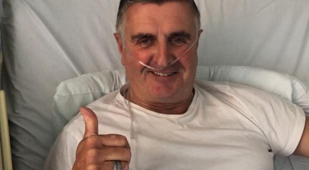 Martin Donnelly gives the thumbs-up from his hospital bed