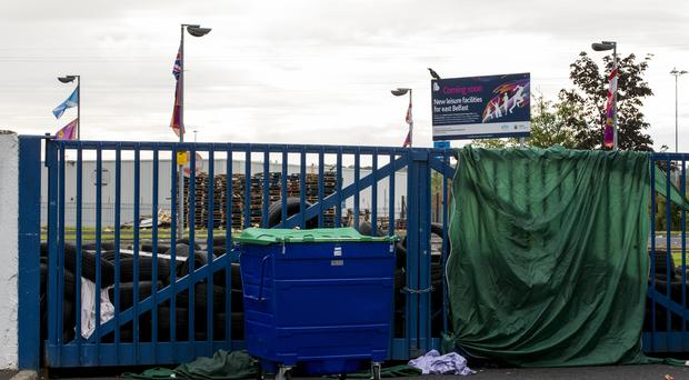 Loyalists kept watch at Avoniel Leisure Centre in case police and contractors moved in to demolish a Twelfth of July bonfire under council orders (Liam McBurney/PA)
