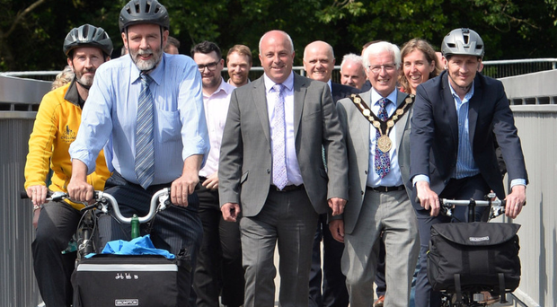 Members of Lisburn & Castlereagh City Council and representatives of the Department for Infrastructure on the new pedestrian and cycle bridge connecting the Comber Greenway and Dundonald Leisure Park