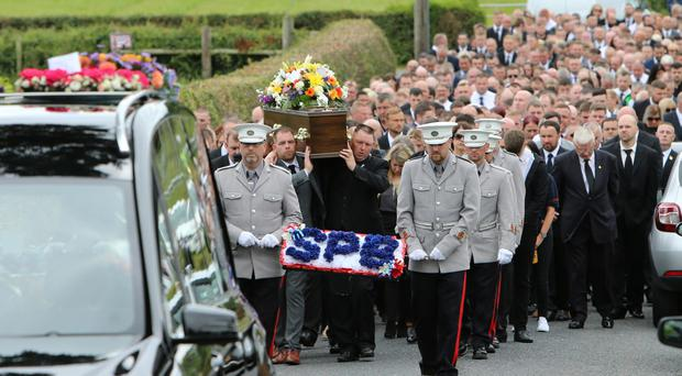The coffin of Darren Williams is carried during his funeral yesterday