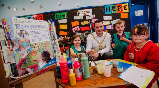Cliodhna, Thomas and Niamh welcomed Lord Mayor of Belfast Councillor John Finucane when he stopped by the North Queen Street summer scheme
