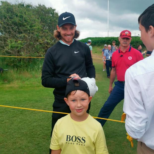 Noah Adnett (5) meets Tommy Fleetwood