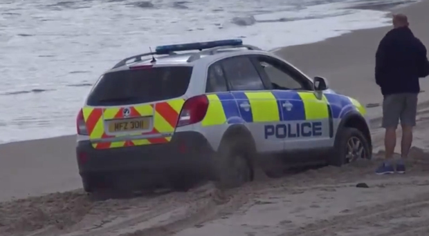 The PSNI patrol vehicle gets stuck on White Rocks beach yesterday