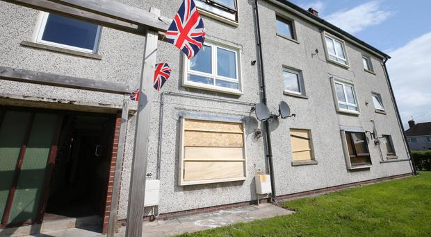 The scene at Sunnylands Grove in Carrickfergus, Co Antrim, after an attack on a property