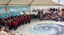 The Portrush Sons of Ulster, a Loyalist flute band, play in Portrush town centre (David Young/PA)