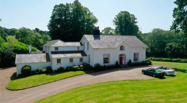 Ballyaughlis Lodge, set within five acres of grounds seven miles south central Belfast