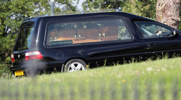 The hearse carrying the coffin of John Blaney arrives for the funeral service at St Patrick's Church, Saul