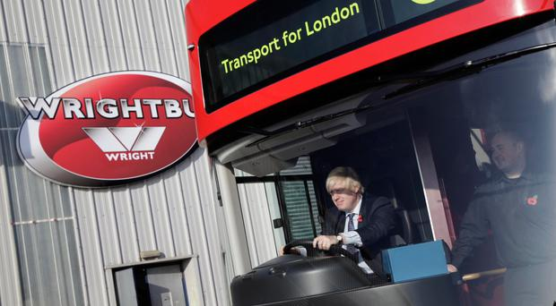 Then Mayor of London Boris Johnson gets to grips with the first new bus for London at the Wrightbus factory in Ballymena in 2011