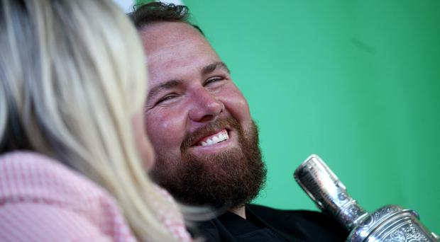 Shane Lowry with his wife Wendy Honner during the homecoming event (Donall Farmer/PA)
