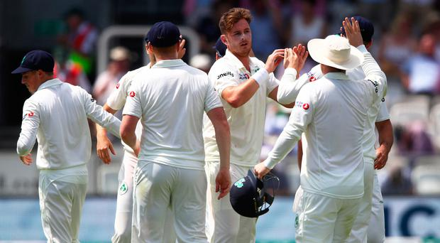 Mark Adair of Ireland is congratulated for taking the wicket of Olly Stone of England on day one of the Specsavers Test match