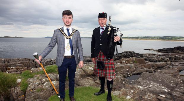 Mayor of Causeway Coast and Glens Borough Council Sean Bateson with a piper