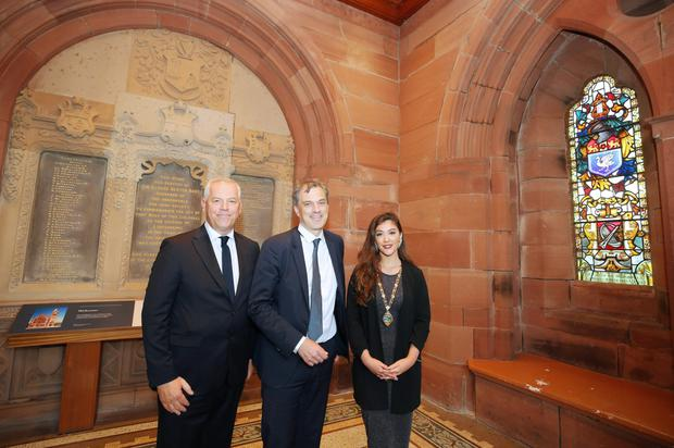Julian Smith with Derry City and Strabane District Council deputy mayor Cara Hunter and CEO John Kelpie at the Guildhall