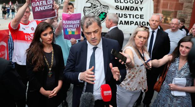 New Secretary of State Julian Smith arrives at the Guildhall in Londonderry yesterday