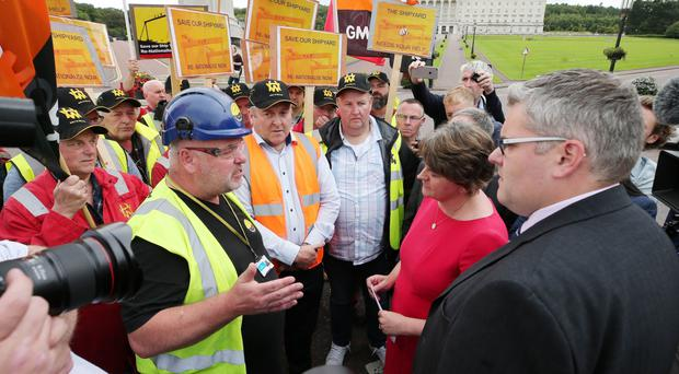 DUP leader Arlene Foster speaks to Harland & Wolff workers who were holding a protest over the future of the shipyard