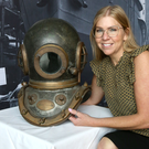 Maeve Moreland, destination manager of Titanic Foundation, with an old standard diving dress